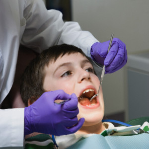 Boy being examined by dentist