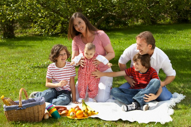 Germany, Bavaria, Family having picnic --- Image by © Roman Marzinger/Westend61/Corbis
