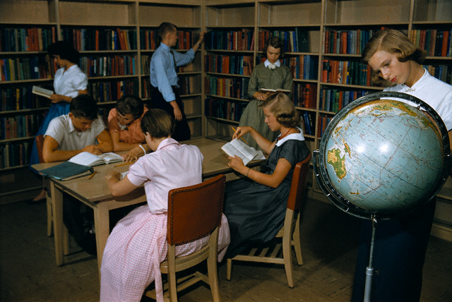 ca. 1950-1965 --- High School Students Studying in Library --- Image by © William Gottlieb/CORBIS