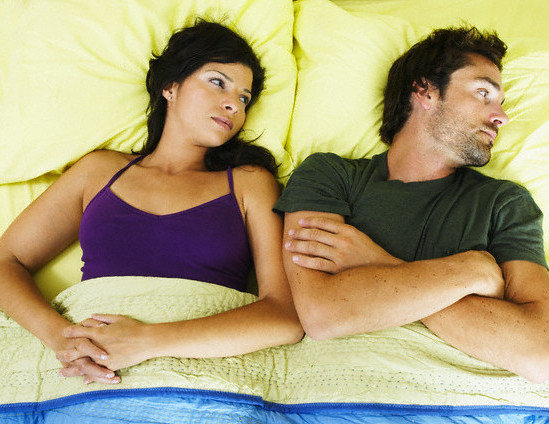Angry Couple in Bed --- Image by © Mango Productions/Corbis