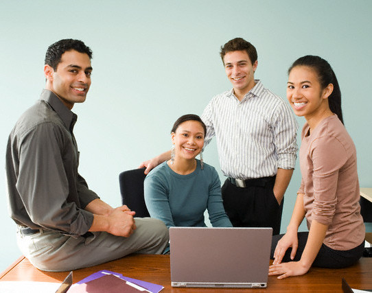 Co-workers smiling --- Image by © Bill Varie/Somos Images/Corbis